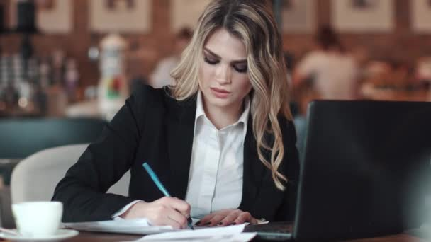 depositphotos_185589524-stock-video-a-business-woman-signs-documents.jpg
